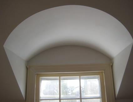 Plaster arched window opening
